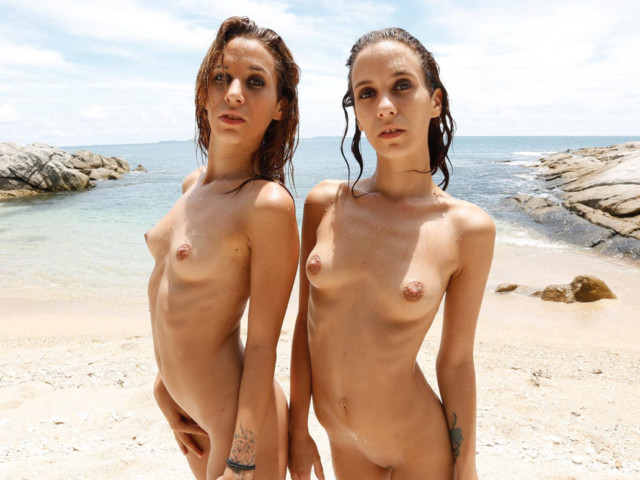 Fully-Nude Fox Twins perking out their tiny pointy breasts