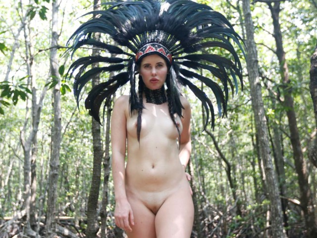 Shaved pussy and naked tits in the forest