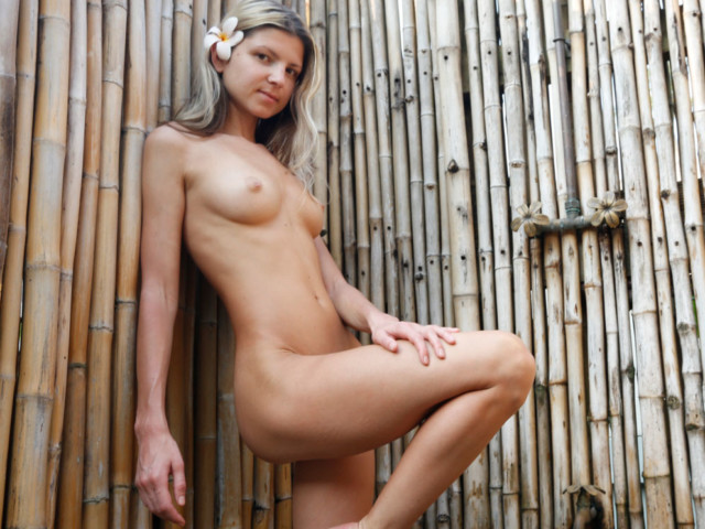 Blond nude in outdoor shower