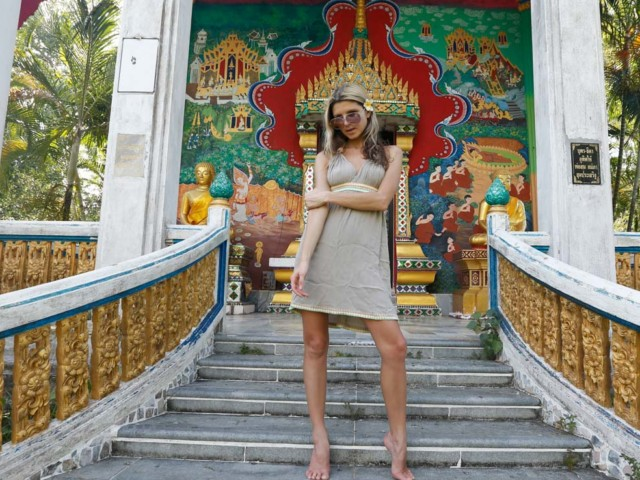 Blonde babe poses at temple
