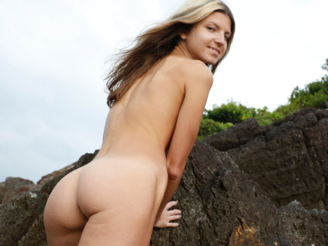 Naked blonde at the shore