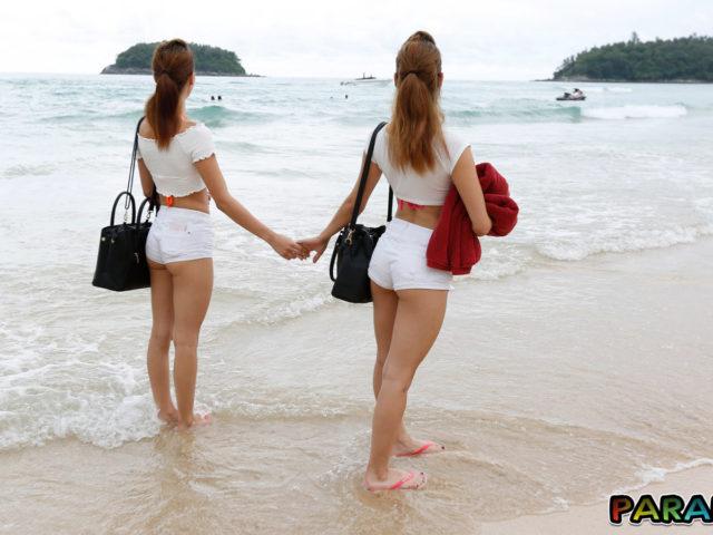 Beach Bikini Twins arrive at the sandy shore