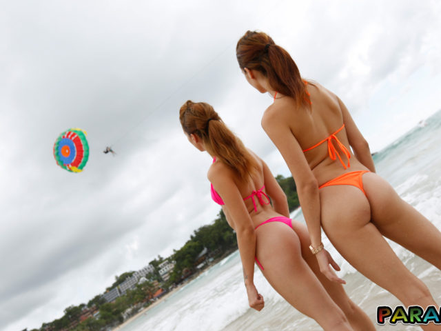 Beach Bikini Twins let me see their thong butt cheeks while they watch paraglider