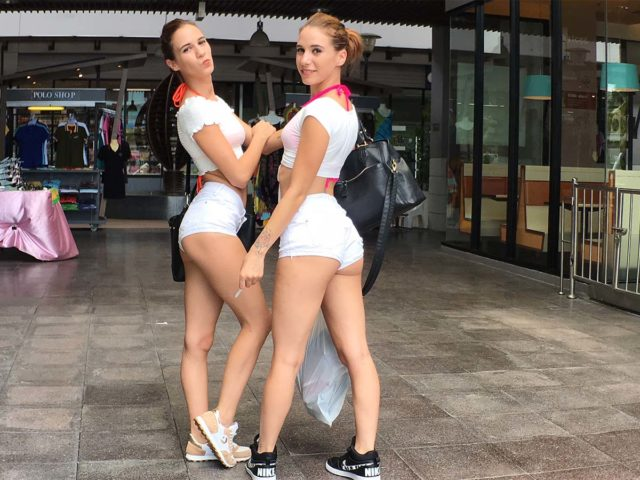 Sexy twins in short shorts at mall